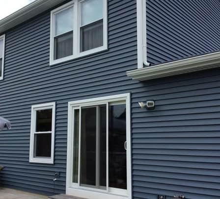 new blue siding, sliding door installation